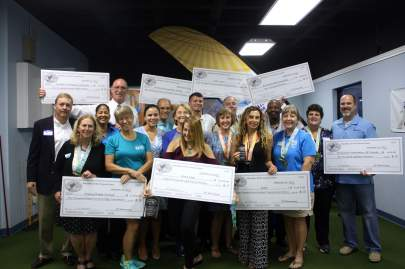 The Treasure Coast Marathon awarded checks to nine nonprofits at a reception at Oceanside Physical Therapy. Charities raised funds for their organizations and assisted the Marathon.